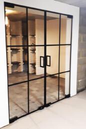 Dubbele pivoterende steel look deur