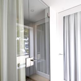 glazen deuren op maat - Pivoterende glazen deuren